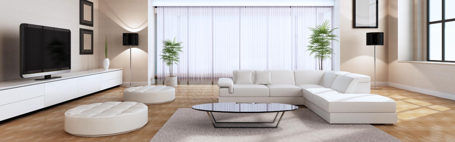 Biała sofa rogowa w pokoju dziennym